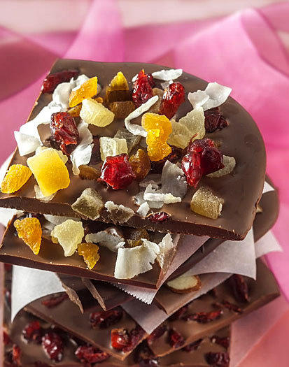 "Chocolate bark<br> <br> <i>Note:</i> Adapted from ""The Liddabit Sweets Candy Cookbook,"" by Liz Gutman and Jen King, who write: ""You can use any type of chocolate you like -- dark, milk, white (or a combo) -- and pretty much any topping."" Use a single topping or a combo of two or three.<br> <br> <b>Prep:</b> Line a 9-by-13-inch rimmed baking sheet with parchment paper. Be sure paper extends over the two long sides of the baking sheet to act as handles to lift out bark.<br> <br> <b>Temper:</b> Put 2 cups chopped chocolate (13 ounces) in a microwave-safe bowl. Microwave on high, 30 seconds. Stir well. Microwave on high 10 to 15 seconds at a time, stirring after each interval, until chocolate is melted.<br> <br> <b>Form:</b> Pour chocolate into lined baking sheet; tap pan gently on counter a few times to remove any bubbles and distribute chocolate in a uniform layer. Quickly sprinkle 1 1/2 cups toppings evenly over chocolate. If toppings don't stick easily, use another sheet of parchment paper to press toppings down gently. Let set, 1 hour.<br> <br> <b>Break up:</b> When firm, run a sharp knife along unlined edges of the baking sheet to loosen bark. Using parchment paper handles, gently lift bark from baking sheet. Carefully peel paper off bark. Gently break bark into 2- to 3-inch pieces. Store bark in an airtight container, up to 2 weeks.<br> <br> <b>Toppings:</b> Chopped nuts (almonds, pecans, walnuts, peanuts, pistachios), shelled pumpkin seeds, chopped dried fruit (cranberries, raisins, apricots), broken snack pieces (pretzels, potato chips), cereal (Golden Grahams, Rice Krispies, Cap'n Crunch).<br> <br> Makes: About 11/2 pounds<br> <br> <a href=http://www.chicagotribune.com/features/food/sc-food-0208-valentines-treats-20130213,0,2311034.story> Read the Good Eating story </a>"