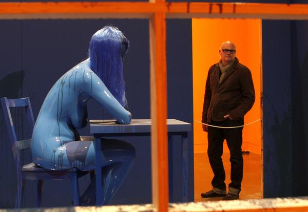"Orange County Museum of Art director Dennis Szakacs looks at Richard Jackson's installation ""Blue Room,"" 2011/2013, which refers obliquely to a Duchamp chess game."