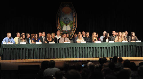 Ten students participate in signing day for Division I athletes from Emmaus High School on Wednesday.