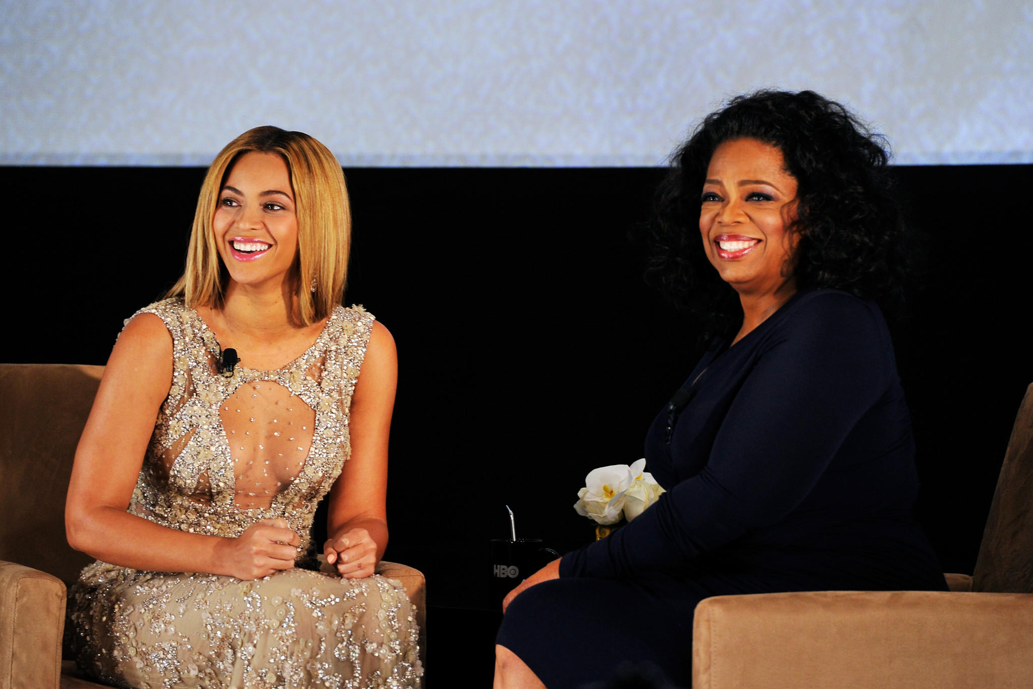 Beyoncé, left, and Oprah will join other celebrities in an hourlong fundraiser for Hurricane Harvey relief. (Larry Busacca / Getty Images)