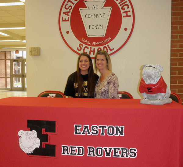 Arian Grays (left) participates in signing day for Division I athletes at Easton High School on Wednesday.