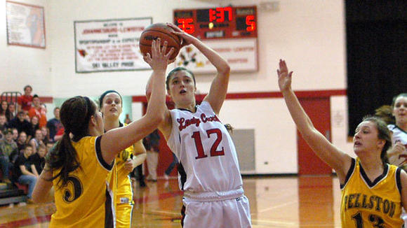 With this short jump shot, J-L senior Abby Schlicher reached 1,000 career points on Tuesday as the Cardinals blew by Pellston, 66-21.