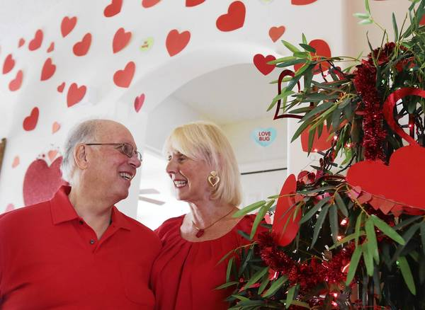 Rosella and John Valentine of Leesburg decorate their home with more than 300 red hearts, flowers an heart-shaped objects for Valentine's Day each year. The Valentines have been married 42 years.