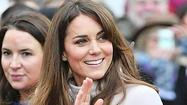 Britain's Catherine, Duchess of Cambridge waves to crowds in Cambridge, central England