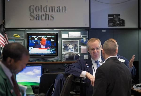 Traders work at the Goldman Sachs booth on the floor of the New York Stock Exchange last month.