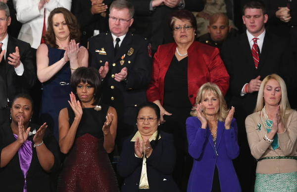 Teacher Kaitlyn Roig, far right in front, attended the State of the Union address Tuesday night as a guest of first lady Michelle Obama. Roig locked herself and her students in a bathroom as Adam Lanza shot 26 students and staff at Sandy Hook school.