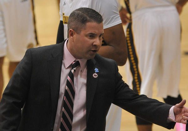 Towson men's basketball coach Pat Skerry walks around at halftime against Delaware State on Feb. 6.