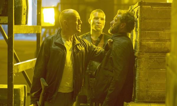 "Bruce Willis, left, Jai Courtney and Sebastian Koch star in ""A Good Day to Die Hard."""