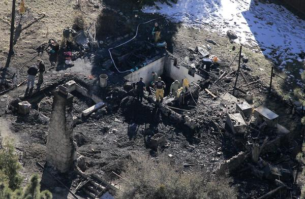 "After what LAPD Chief Charlie Beck called ""a bittersweet night,"" investigators Wednesday were in the process of identifying the human remains found in the charred cabin where fugitive ex-cop Christopher Dorner was believed to have been holed up after trading gunfire with officers, authorities said."
