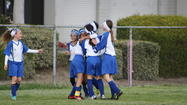 Blue Crushers players celebrate the winning goal scored by Niki Serrano against Cerritos Sunday.