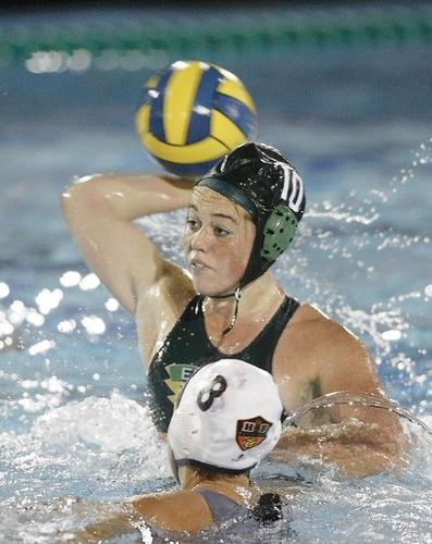 Edison High's Risa Burke (10) scores against Huntington Beach's Samantha Preston (8) during the first half in a Sunset League game.