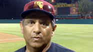 USC fired baseball coach Frank Cruz for knowingly violating NCAA rules that limit the number of hours athletes can spend in activities directed or supervised by the coaching staff, Athletic Director Pat Haden said.