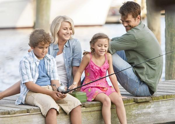 "Noah Lomax, left, Julianne Hough, Mimi Kirkland and Josh Duhamel star in ""Safe Haven."""