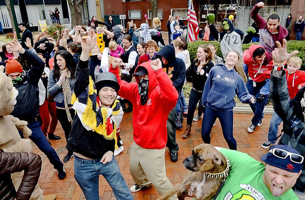Flash mob participants do the Harlem Shake on Public Square in downtown Hagerstown Wednesday afternoon.
