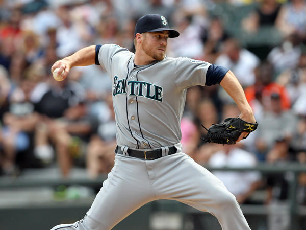 Seattle traded right-handed reliever Shawn Kelley to New York for minor league outfielder Abraham Almonte.