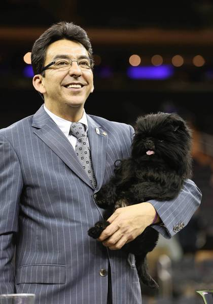 Dog handler Ernesto Lara holds Banana Joe, an Affenpincher, after he won Best in Show at the 137th Westminster Kennel Club Dog Show on February 12, 2013 in New York City.