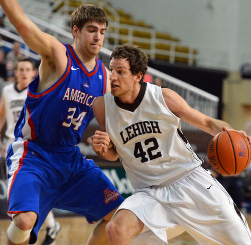 Lehigh's Gabe Knutson (42) drives against American's Tony Wroblick (34) during a men's basketball game at Stabler Arena on Wednesday.