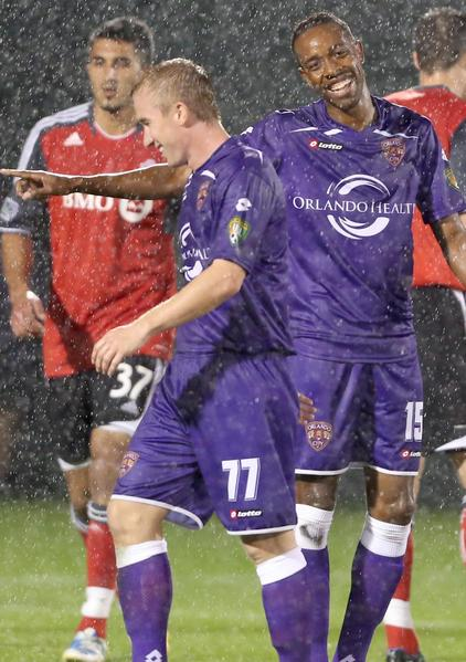 Orlando's Dennis Chin (15) smiles with teammate Jamie Watson (77) during the Orlando City Soccer versus Toronto FC at the Walt Disney World Pro Soccer Classic at the ESPN Wide World of Sports Complex in Orlando on Wednesday, February 13, 2013.