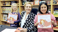 Hundreds of fans crowded Flintridge Bookstore and Coffeehouse on Monday night to see Julie Andrews.
