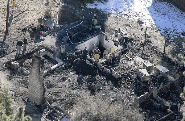 Investigators on Wednesday were tryng to identify the human remains found in the charred cabin where fugitive ex-LAPD Officer Christopher Dorner was believed to have been holed up after trading gunfire with officers near Big Bear, authorities said.