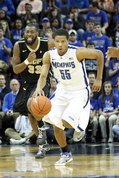 Memphis Tigers guard Geron Johnson (55) leads a fast break during the first half as Central Florida Knights forward Keith Clanton (33) pursues at the FedEx Forum.