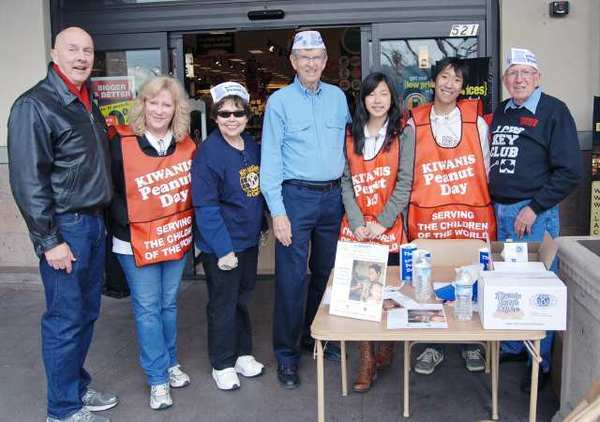 La Cañada Kiwanis Club members sold peanuts at Ralphs to raise money for the Kiwanis Eliminate Project. The goal of the project, run in collaboration with UNICEF, is to eliminate maternal and neonatal tetanus. From left are Kiwanians Thomas A. Passanisi, Gigi Schlueter, Peggy Touchstone and Stewart Lee, Key Club members Christine Noh and Colin Suehiro and Kiwanis Key Club advisor Ken Lowe.