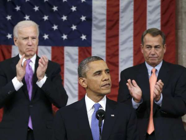 U.S. House Speaker John Boehner (R-OH) and Vice President Joe Biden (L) applaud as President Barack Obama delivers his State of the Union speech on Capitol Hill in Washington last night