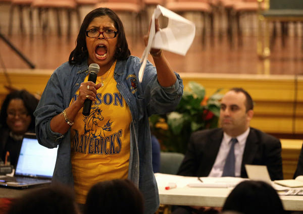 Rita McNeal, a 5th grade teacher at Roswell Mason Elementary School, argues to keep the school open as CPS releases a preliminary list of schools that could be closed during a public forum at House of Prayer Church of God in Christ on Chicago's West side.