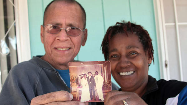 FROM LEFT: El Centro residents Miguel Rodriguez and Willie Rodriguez show their wedding photograph taken 36 years ago in Virginia. In the photo Miguel, in his U.S. Army uniform, is accompanied by Willie's brother, Dwight Tyler.