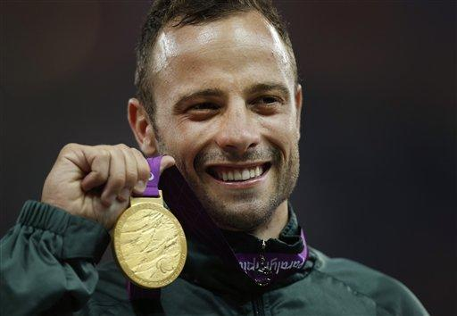 "In this Sept. 8, 2012, file photo, South Africa's Oscar Pistorius poses with his gold medal after winning the men's 400 meters at the 2012 Paralympics, in London. Olympic sprinter Pistorius has been arrested after a 30-year-old woman was shot dead at his home in South Africa. Pistorius, a double-amputee known as ""Blade Runner,"" was taken into custody after the shooting early Thursday."
