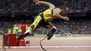 Olympic 'Blade Runner' Pistorius charged in girlfriend's murder