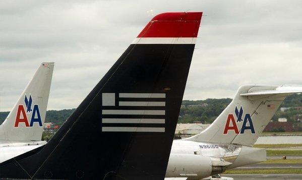 US Airways and American Airlines jets on the tarmac at Ronald Reagan Washington National Airport in Arlington, Va.