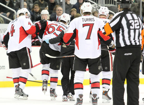 Ottawa Senators defenseman Erik Karlsson (65) is helped off the ice after being injured during the second period.