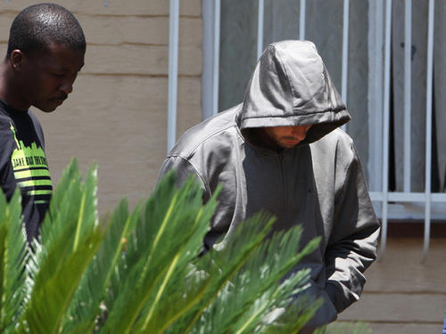 Oscar Pistorius leaves Boschkop Police Station on Feb. 14 in Pretoria, South Africa.