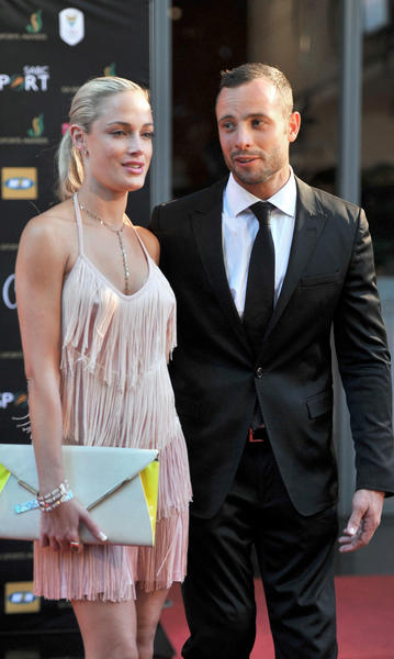 This picture taken on Nov. 4, 2012 during the Feather Awards held at Melrose Arch in Johannesburg shows South Africa's Olympic sprint star Oscar Pistorius and his model girlfriend Reeva Steenkamp.