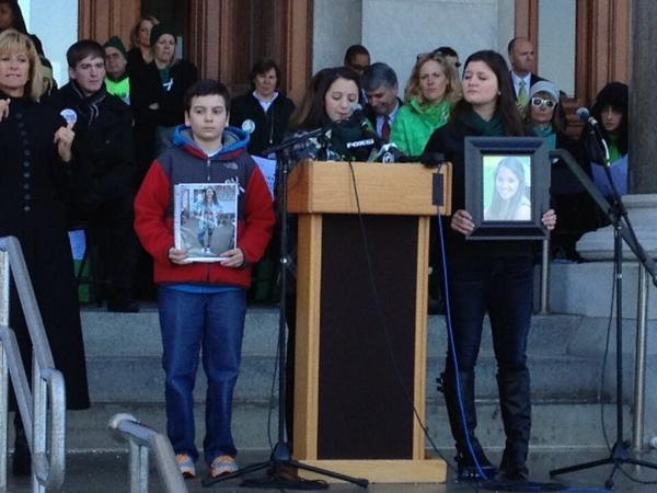 The family of Victoria Soto speaks Thursday at a rally seeking changes to the state's gun laws. Soto was a teacher at Sandy Hook Elementary School and was killed in the Dec. 14 shooting there.