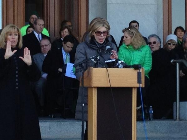 Actress Christine Baranski speaks at the state Capitol Thursday, the two-month anniversary of the shooting at Sandy Hook Elementary School, during a rally seeking changes to the state's gun laws.