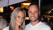 The former coach of Olympic runner Oscar Pistorius said he was stunned by the news that the double-amputee was arrested Thursday in connection with the slaying of girlfriend Reeva Steenkamp.