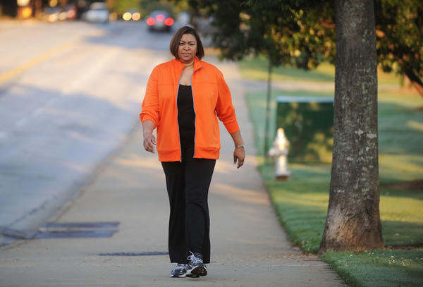 Extended periods of low intensity exercise, such as walking or standing, improved insulin and lipid levels more effectively than an hour of intense exercise, according to one study. Above, a woman walks for exercise in Piedmont Park in Atlanta, Georgia, on August 13, 2012.