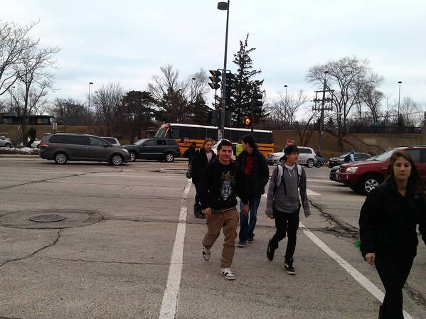 Students cross the intersection at Green Bay Road and Winnetka Avenue.