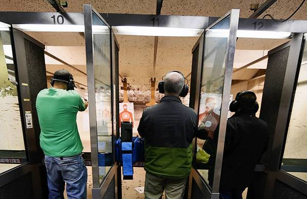 "People fire various guns at the ""Get Some Guns & Ammo"" shooting range on Jan. 15, 2013, in Salt Lake City."
