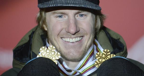 Ted Ligety holds up the two gold medals he has won at this year's world championships.