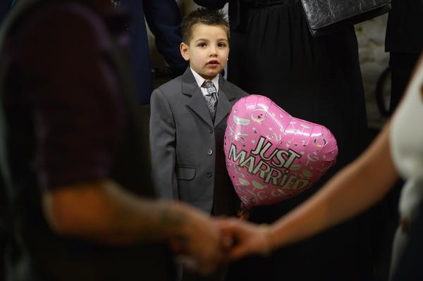 Kieran Lewis, 4, attends the wedding of Michael Lewis and Rebecca Anderson on Valentine's Day in Gretna, Scotland. Gretna Green is one of the most popular wedding destinations in Scotland, hosting thousands of weddings each year, with a particular rise on St Valentine's Day. Gretna Green has been hosting marriages in the blacksmith's shop since 1754.