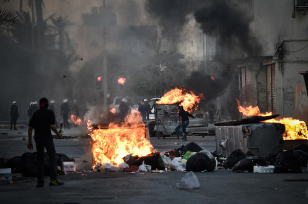 Protesters clash with security forces following a rally to mark the second anniversary of an uprising in Bahrain on Thursday in the village of Sanabis, west of Manama.