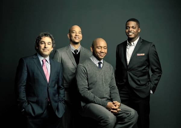 The Branford Marsalis Quartet features, left to right, Joey Calderazzo (piano), Eric Revis (bass), Branford Marsalis (saxophones), and Justin Faulkner (drums).