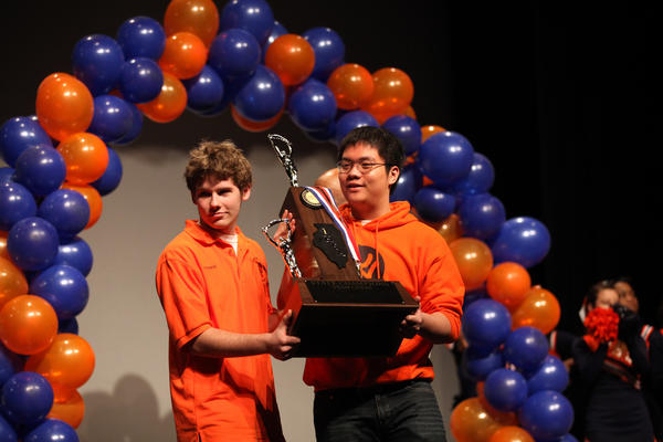 Sam Schmakel, left, a junior and four-time national chess champion, and Phuc Hoang, also a junior, hold the trophy as the chess team at Whitney Young Magnet High School is honored as state champions this year.
