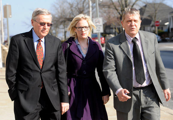 Megan Thode, center, walks outside the Northampton County Courthouse with her father Stephen Thode, left, and her attorney Rick Orloski before losing her case against Lehigh University in Northampton County Court Thursday. Judge Emil Giordano decided that the university neither breached contract nor sexually discriminated against Megan Thode, whose lawsuit sought $1.3 million in damages.