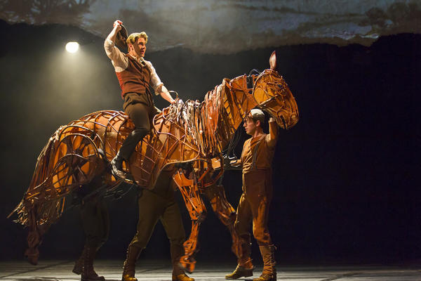 "Albert (Andrew Veenstra) rides Joey in the play ""War Horse."""