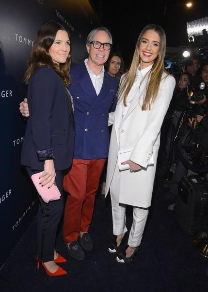 From left ,  Drew Barrymore, Tommy Hilfiger and Jessica Alba pose at the Tommy Hilfiger West Coast flagship opening in West Hollywood on Wednesday.