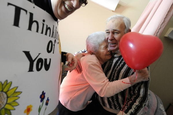 Paula Dunn, 92, gives a hug to Jack Rodin after Rodin delivered three Valentine wishes, a flower and balloon to her at the Hebrew Health Care home in West Hartford Thursday. The Rodin family created SonnyGram a card delivery service for current residents in memory of Rodin's wife Sonny.